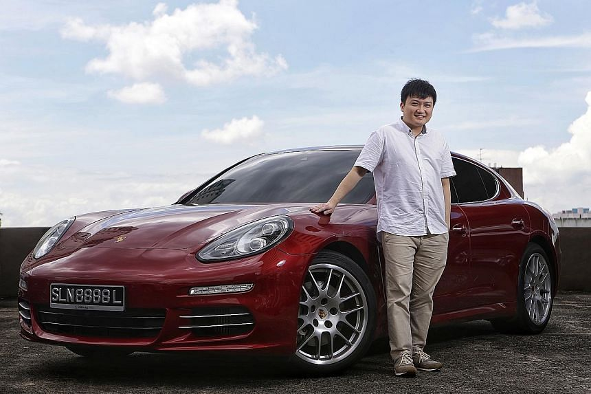 Mr Anthony Fok, who runs a tuition centre, takes his students for a ride in the Porsche Panamera S when they do well in their tests.