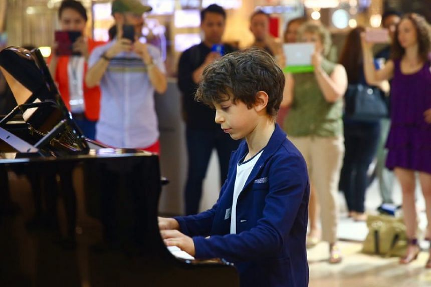 Jesse Collins playing his own composition, a Boogie Woogie improvisation, at Ion Orchard.