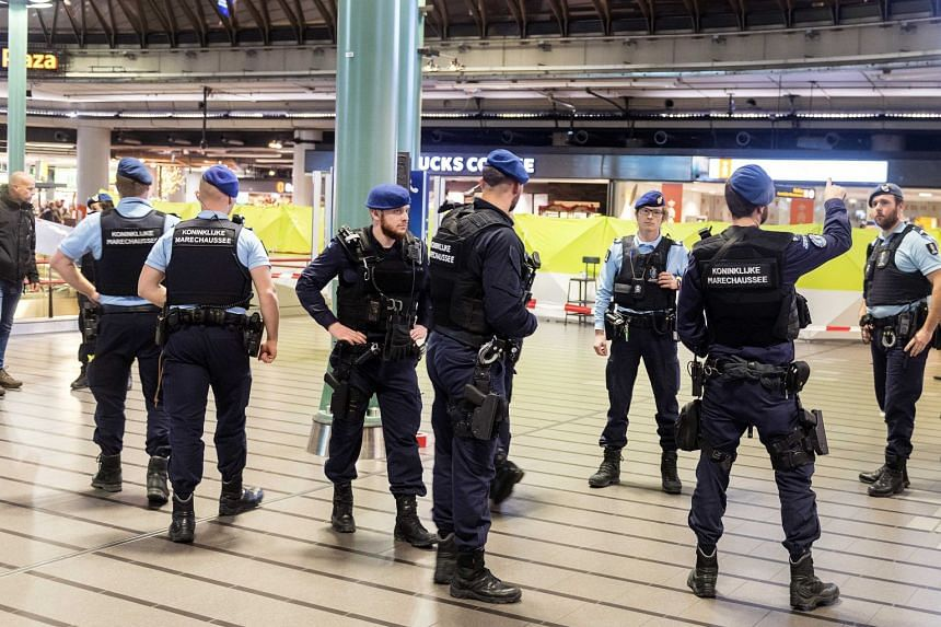 Police patrol after a man wielding a knife was shot by military police at Schiphol Airport in Amsterdam.