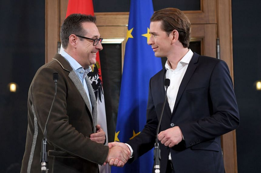 Leader of Austria's conservative People's Party (OeVP), Sebastian Kurz (right), shakes hands with Chairman of the Freedom Party (FPOe), Heinz-Christian Strache on Dec 15.