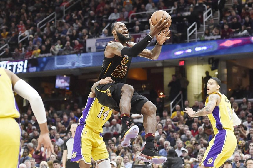 Cleveland Cavaliers forward LeBron James is fouled by Los Angeles Lakers forward Brandon Ingram while driving to the basket during the Cavs' 121-112 victory. James had 25 points, 12 rebounds and 12 assists for his 59th career triple-double in his 15t