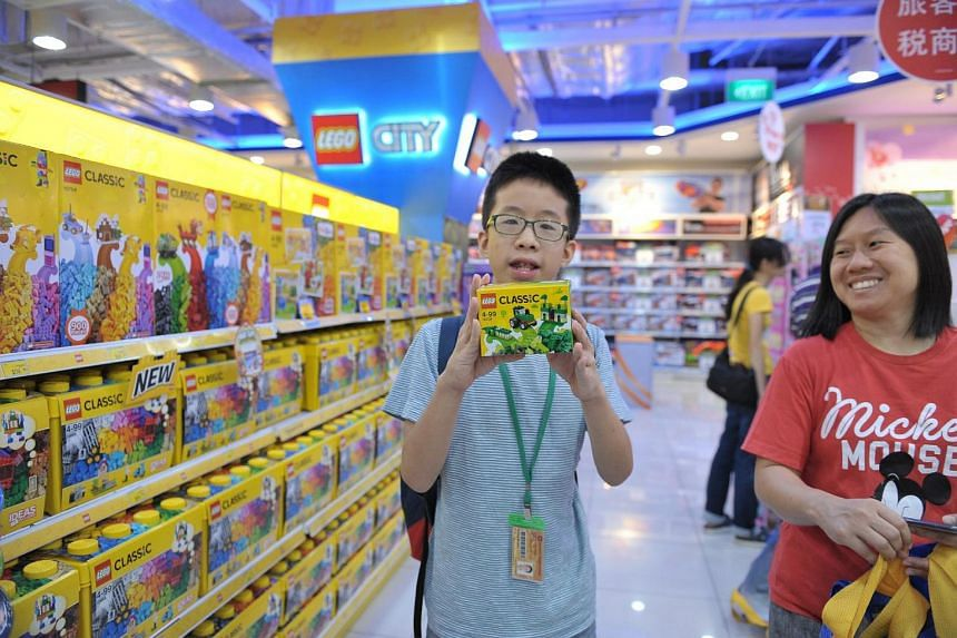 Zhangde Primary School pupil Gabriel Chee, 12, playing with Lego toys at Toys 'R' Us in VivoCity on Dec 16, 2017.
