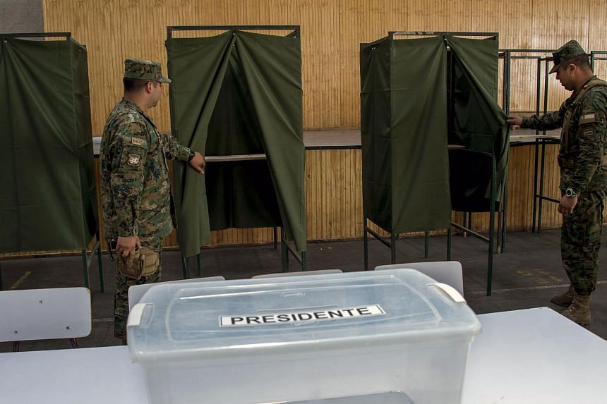 Chilean soldiers inspect the facilities at a polling station at the Amunategui High School in Santiago on Dec 15 ahead of the upcoming presidential election.