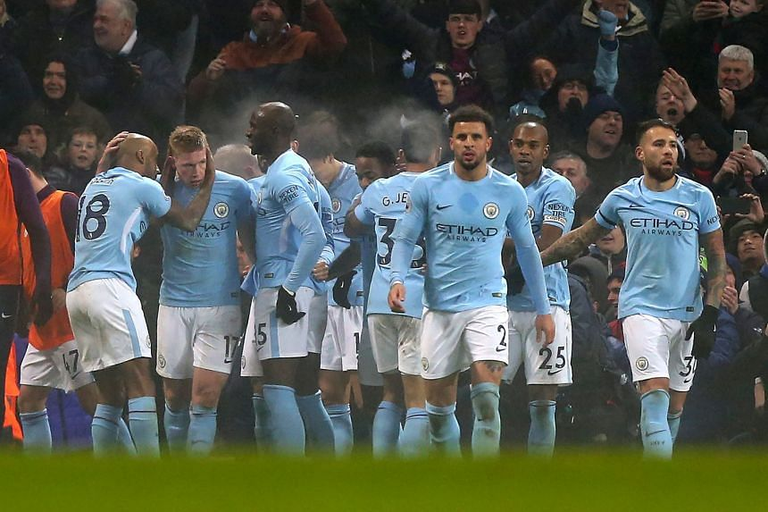 Kevin De Bruyne (second left) celebrates with team mates after scoring City's second goal.