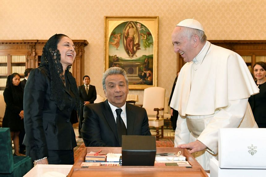 Pope Francis talks with Ecuador's Moreno and his wife Rocio during a private audience at the Vatican.