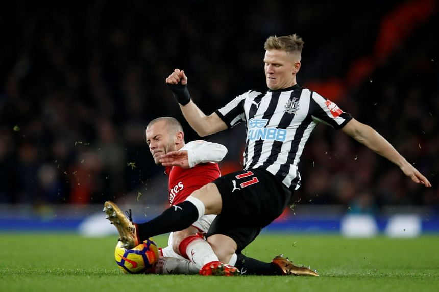 Arsenal's Jack Wilshere in action with Newcastle United's Matt Ritchie.