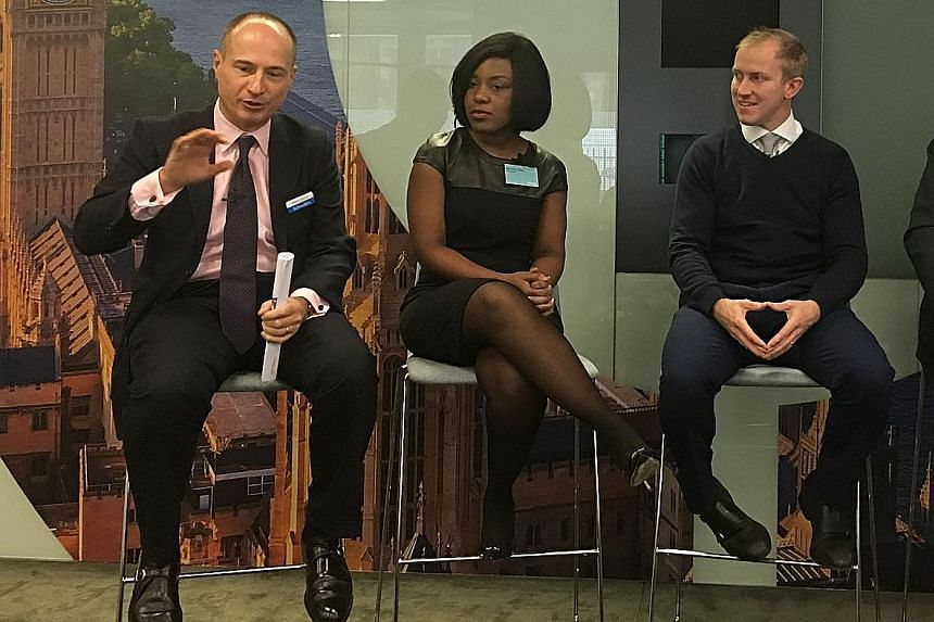 From left: Schroders fund managers Philippe Lespinard, co-head of fixed income; multi-asset fund manager Remi Olu-Pitan; and European equities fund manager James Sym at the Schroders International Media Conference 2017 in London last month.