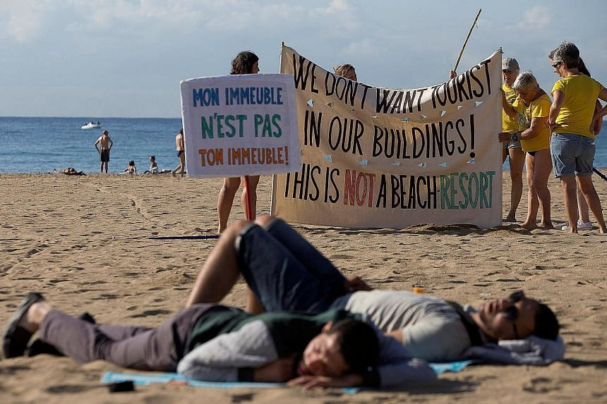 People taking part in a protest against mass tourism in Barcelona in August. The authorities in many European cities are imposing more restrictions on homesharing as neighbours of homesharers get tired of the constant comings and goings in their buil
