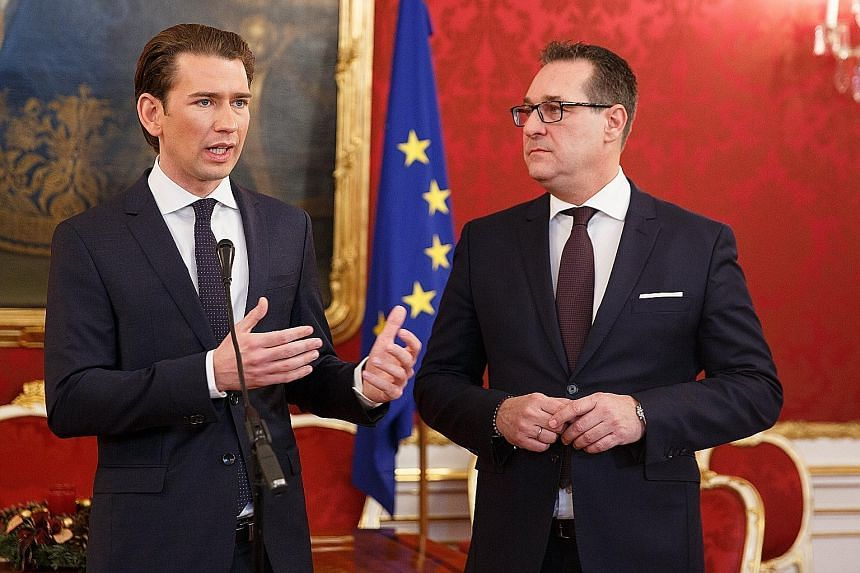 Mr Sebastian Kurz (near right) of the conservative People's Party and Mr Heinz-Christian Strache of the far-right Freedom Party have agreed to form a coalition government in Austria.