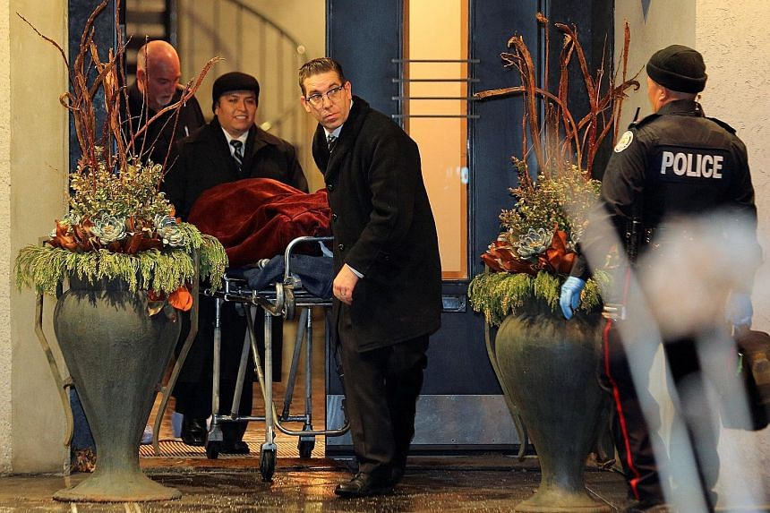 """One of two bodies being removed on Friday from the home of pharmaceutical firm Apotex founder Barry Sherman and his wife, Honey. Police say the circumstances of their deaths were """"suspicious""""."""