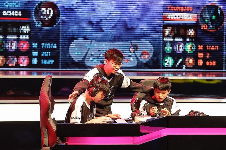 Team Impunity members (from left) Tan Jing Yu, Amos Ker and Nicholas Wong at the semi-finals of the Vainglory World Championship at Kallang Theatre yesterday.