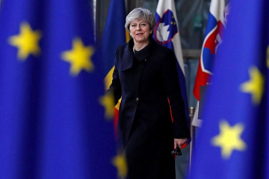 British Prime Minister Theresa May also played down fears of Brexit voters that Britain would end up being bound by EU rules.
