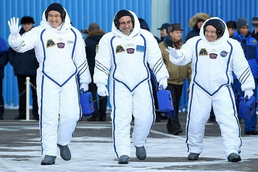 Members of the International Space Station expedition 54/55, (from left) Norishige Kanai of the Japan Aerospace Exploration Agency, Anton Shkaplerov of Roscosmos and Scott Tingle of NASA, during the send-off ceremony for the launch of the Soyuz MS-07