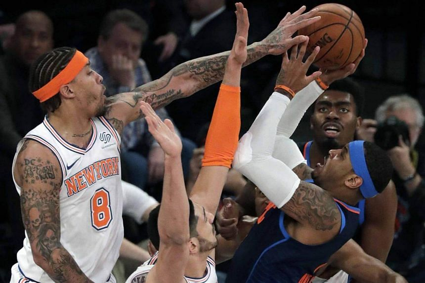 New York Knicks forward Michael Beasley blocks a shot attempt by Oklahoma City Thunder forward Carmelo Anthony during an NBA game at Madison Square Garden in New York on Dec 16, 2017.