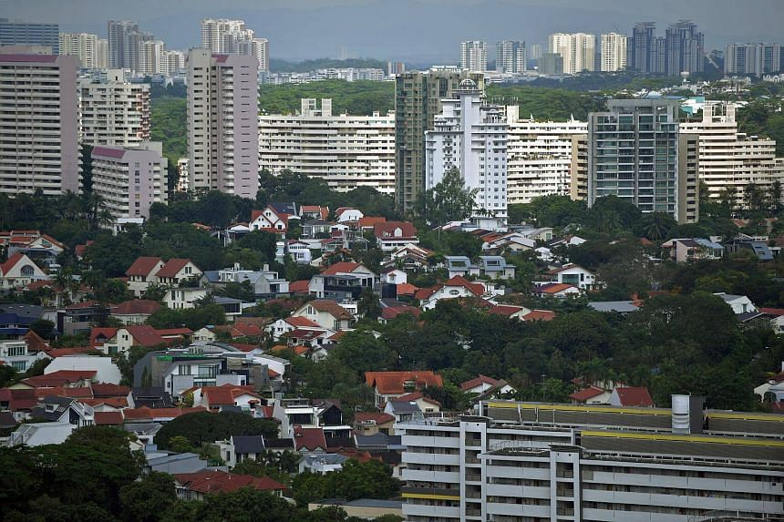 Private houses (front) with blocks of HDB housing flats in the background around Holland Road.