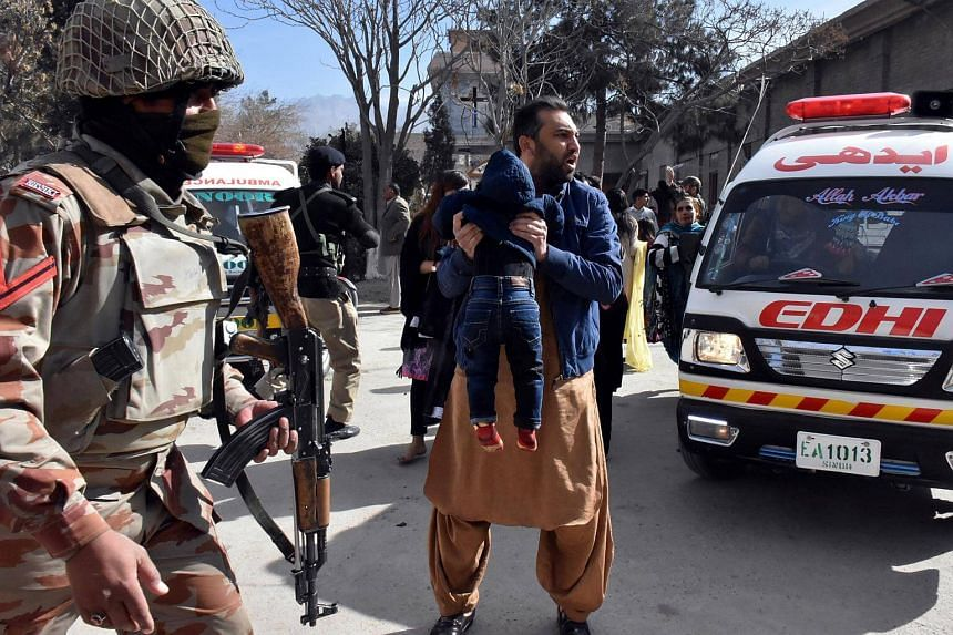 A man shouting for an ambulance while holding a boy, after gunmen attacked the Bethel Memorial Methodist Church in Quetta on Dec 17, 2017.