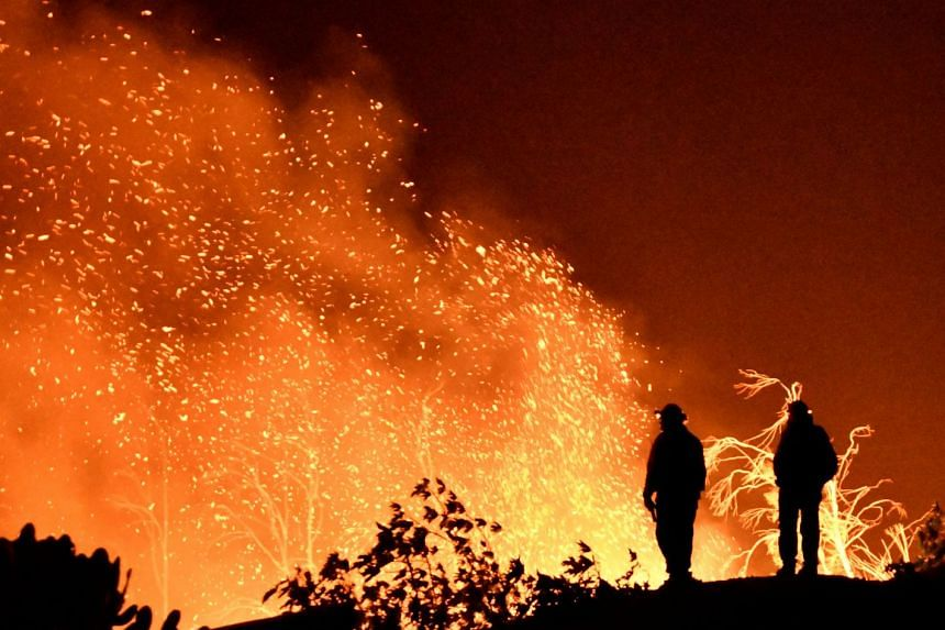Firefighters keeping watch on the Thomas wildfire in the hills and canyons outside Montecito, California, on Dec 16, 2017.