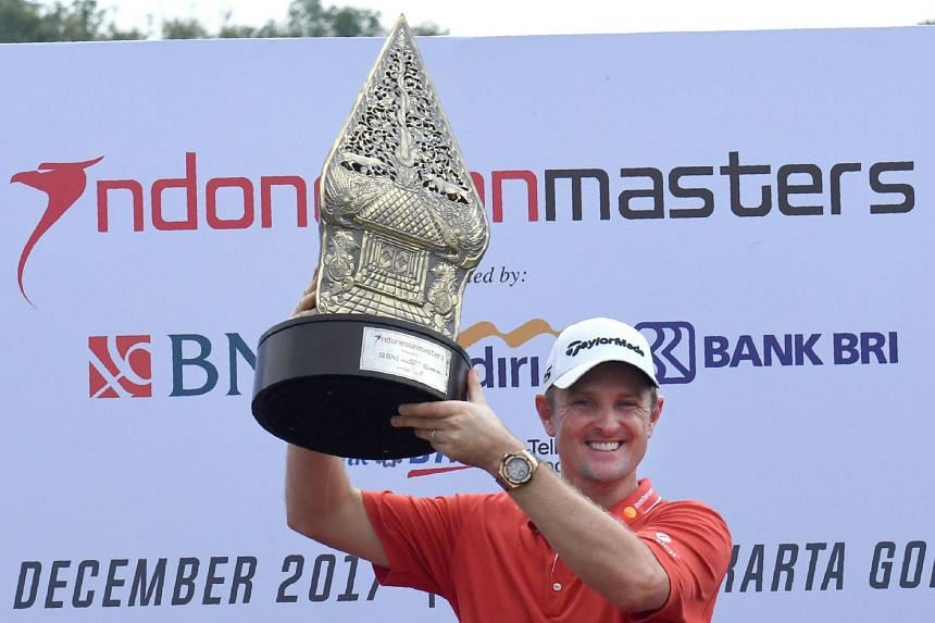 Golfer Justin Rose celebrating with the trophy after winning the Indonesian Masters golf tournament in Jakarta on Dec 17, 2017.