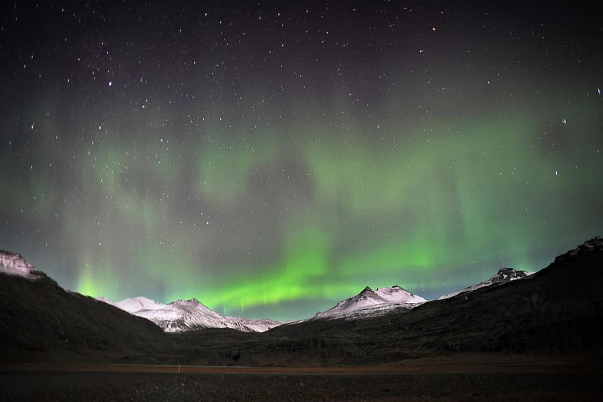 The aurora borealis above Vatnajokull glacier in south-east Iceland. The small Nordic country has seen a boom in tourist numbers, but its government is considering whether the island can afford to to accommodate even more.