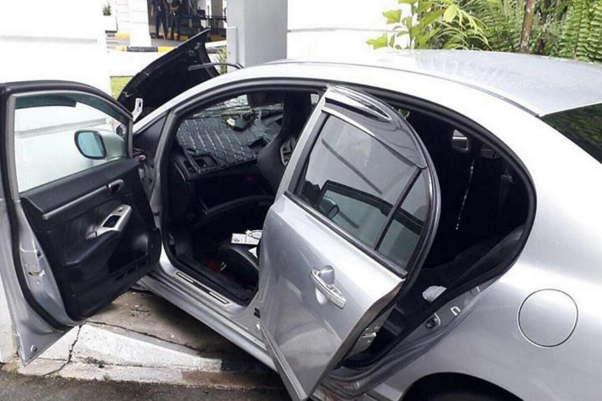 The wreckage of the car outside the Istana.