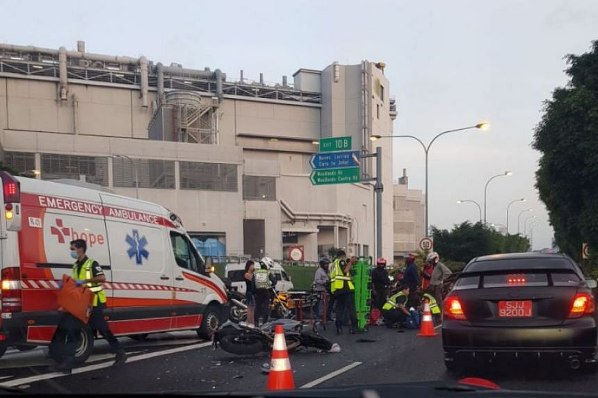 A 22-year-old man suffered fractures to his wrist, and abrasions on his hands and legs after his motorcycle collided with a car on the Bukit Timah Expressway (BKE) on Dec 17, 2017.