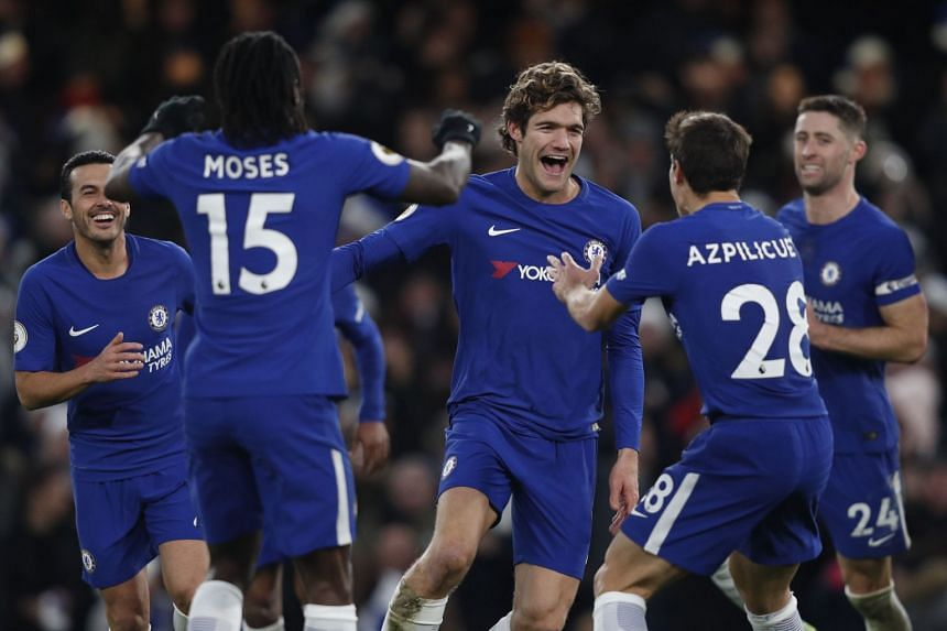Chelsea's Marcos Alonso (centre) celebrates his goal with Victor Moses and Cesar Azpilicueta.