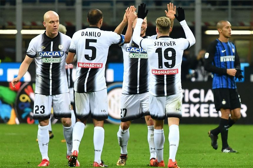 Udinese's players celebrate at the end of the match against Inter.