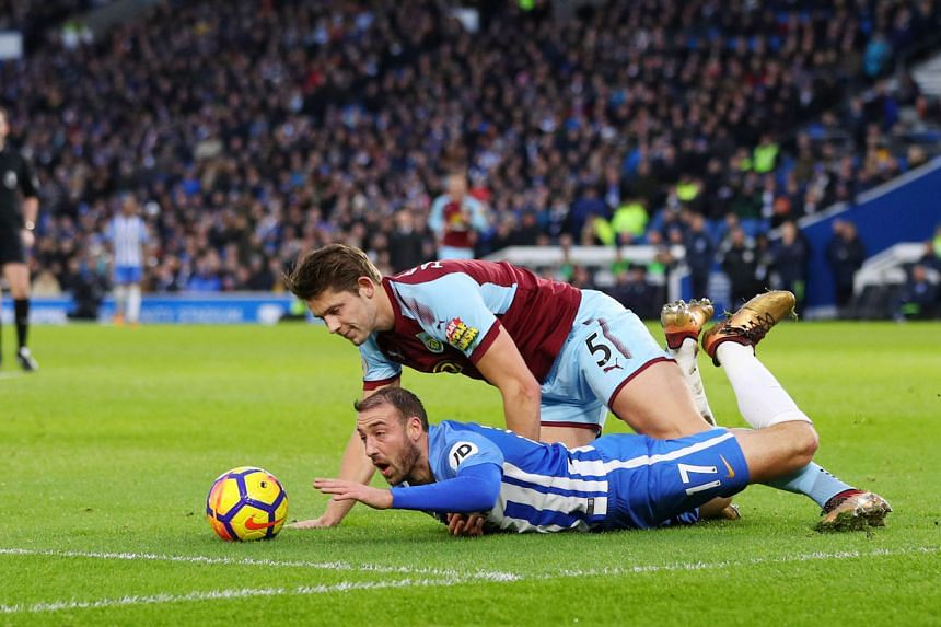 Brighton's Glenn Murray is fouled by Burnley's James Tarkowski to earn a penalty, which Murray blasted over the bar. Visitors Burnley rode their luck to draw 0-0.