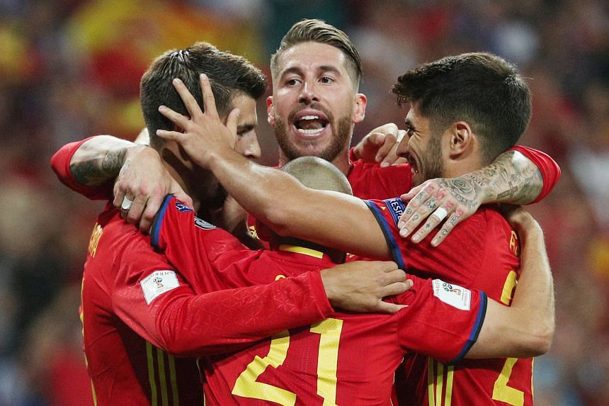Spain captain Sergio Ramos (centre) and team-mates celebrating a goal during their World Cup qualifying campaign. The government's demand for fresh elections for the presidency of the domestic football federation is seen by Fifa as external political