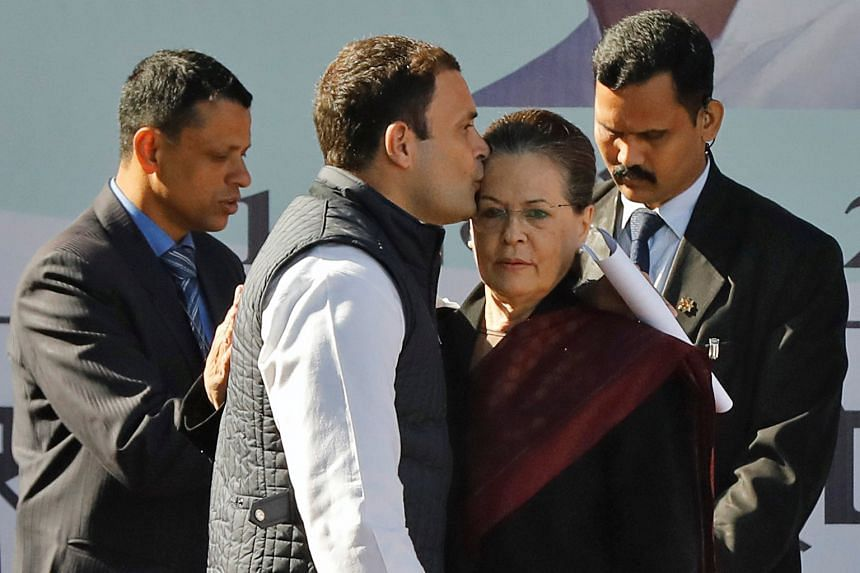New Congress president Rahul Gandhi with his mother Sonia during a ceremony at the party's headquarters in New Delhi yesterday. He was elected unopposed to take over from his mother, who had been at the helm since 1998.