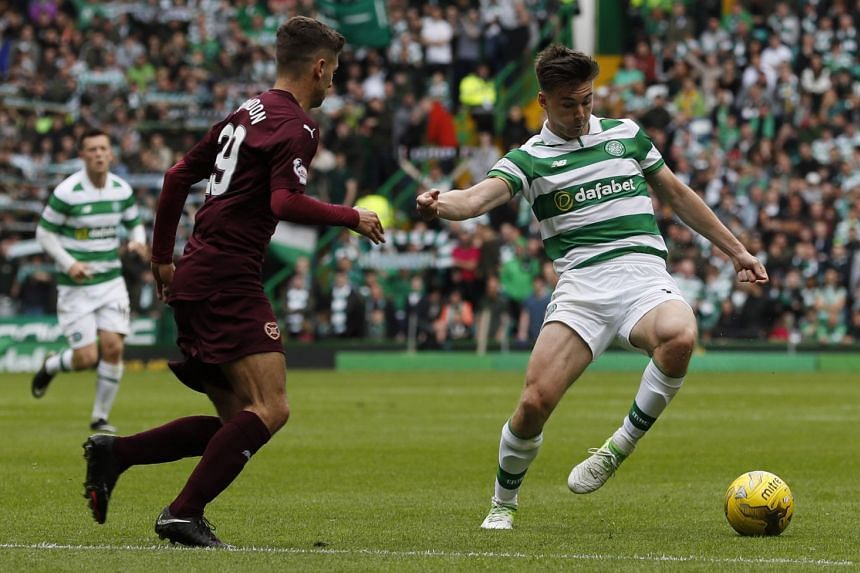 Celtic's Kieran Tierney in action with Hearts' Jamie Brandon in their Scottish Premiership match at Celtic Park on May 21, 2017.