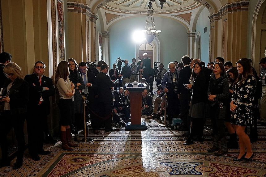 The media waiting to speak to Senate leaders at the US Capitol in Washington. Republican leaders want to vote on the tax Bill early this week so that President Donald Trump can sign it into law before Christmas, making it the most important factor ha