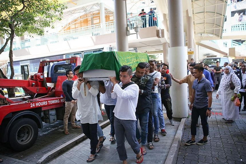 The body of Mr Khairul Anwar Mohd Sani arriving at his home in Whampoa Drive from the mortuary. A friend said Mr Khairul worked as a logistics driver and a part-time Grab and Uber driver.