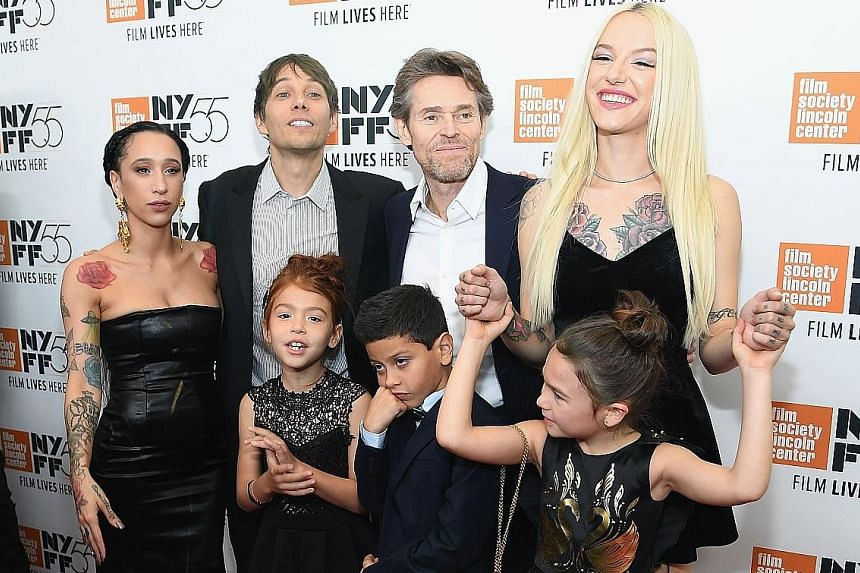 The Florida Project's director Sean Baker (second from left) with cast members (clockwise, from left) Mela Murder, Willem Dafoe, Bria Vinaite, Brooklynn Prince, Christopher Rivera and Valeria Cotto.