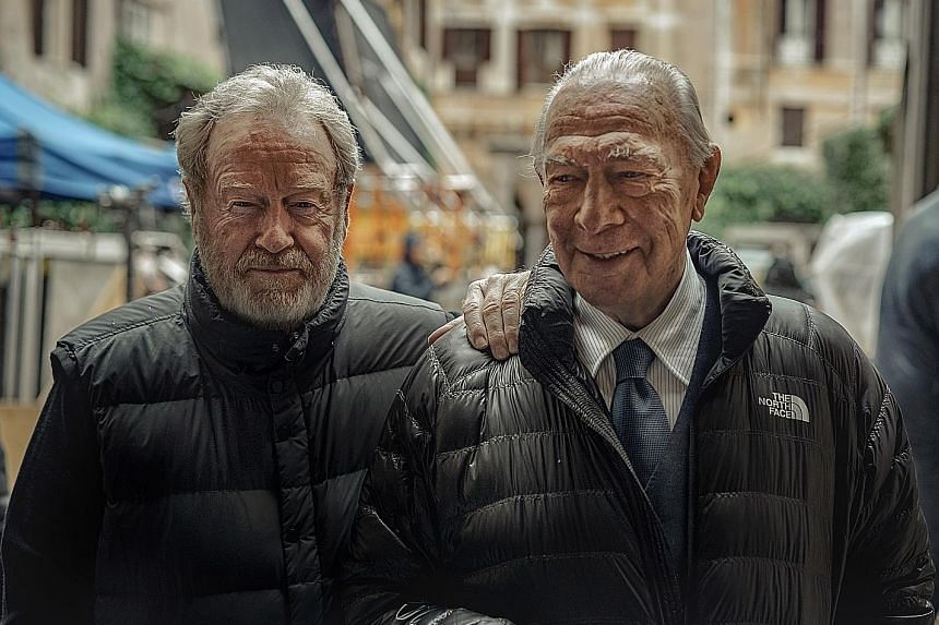 Director Ridley Scott (far left) and actor Christopher Plummer on the set of the movie, All The Money In The World.