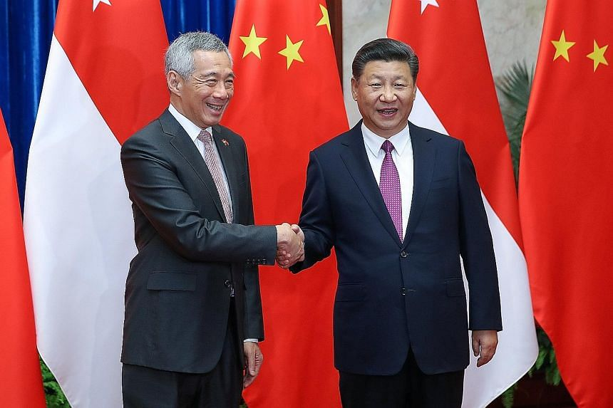 Prime Minister Lee Hsien Loong with Chinese President Xi Jinping before a meeting at The Great Hall Of The People in Beijing on Sept 20. Singapore's ties with China improved after PM Lee's meeting with President Xi and three other members of the apex