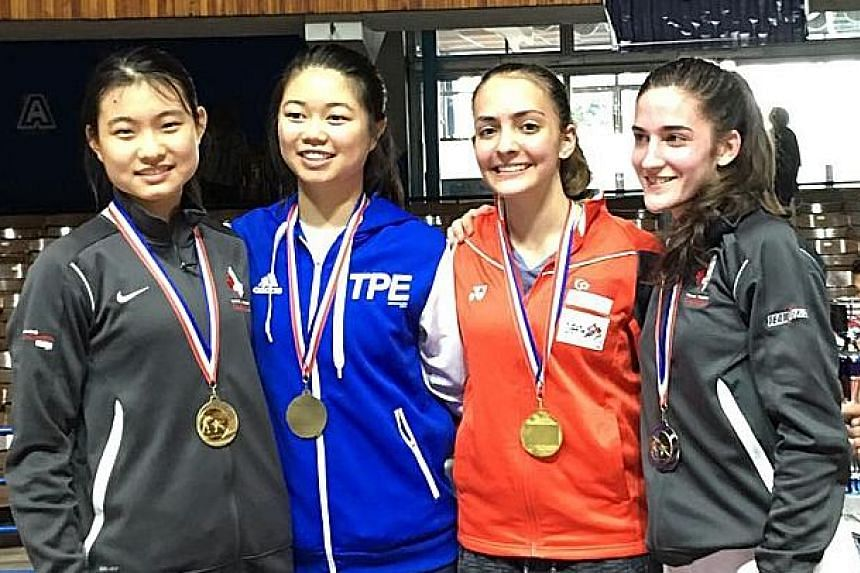 Fencer Amita Berthier (second from right) beat Canada's Naomi Moindrot-Zilliox (right) to win the Junior World Cup. Canada's Cao Ying (left) and Chinese Taipei's Tsai Xiao-qing were the semi-final losers.