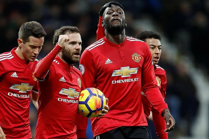 Manchester United's Romelu Lukaku manages a subdued celebration with (from far left) Ander Herrera, Juan Mata and Jesse Lingard for his opening goal against West Brom, where he spent a season on loan. United fended off a late fightback by the hosts t