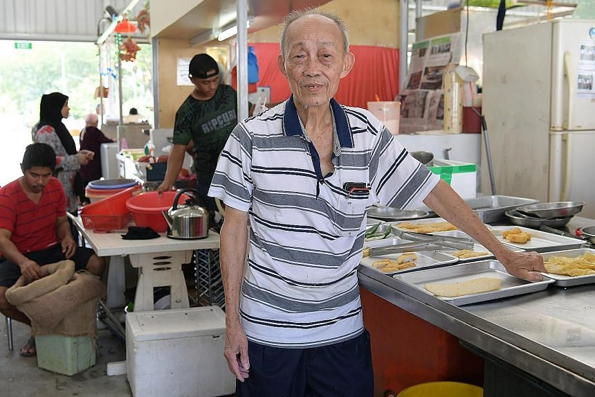Yong tau foo seller Neo Chwee Eng says he now gets around 60 customers a day at the temporary market, fewer than half of what he used to see.