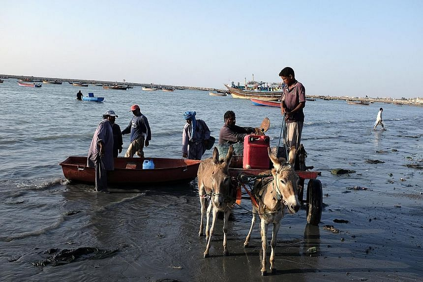 The plan is to turn Gwadar into a transshipment hub and megaport to be built alongside special economic zones. Fishermen take out their catch in Gwadar. Beijing and Islamabad see the fishing town as the future jewel in the crown of the China-Pakistan