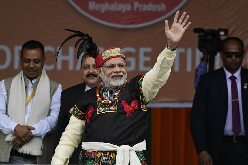 India's ruling Bharatiya Janata Party was in a close fight with the main opposition in an election in Prime Minister Narendra Modi's home state.