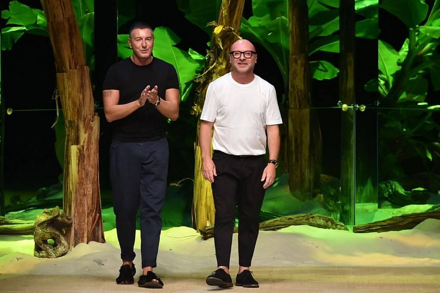 Italian designers Stefano Gabbana (left) and Domenico Dolce at the end of the show for fashion house Dolce Gabbana during the 2017 Women's Spring / Summer collections shows at Milan Fashion Week on Sept 25, 2016