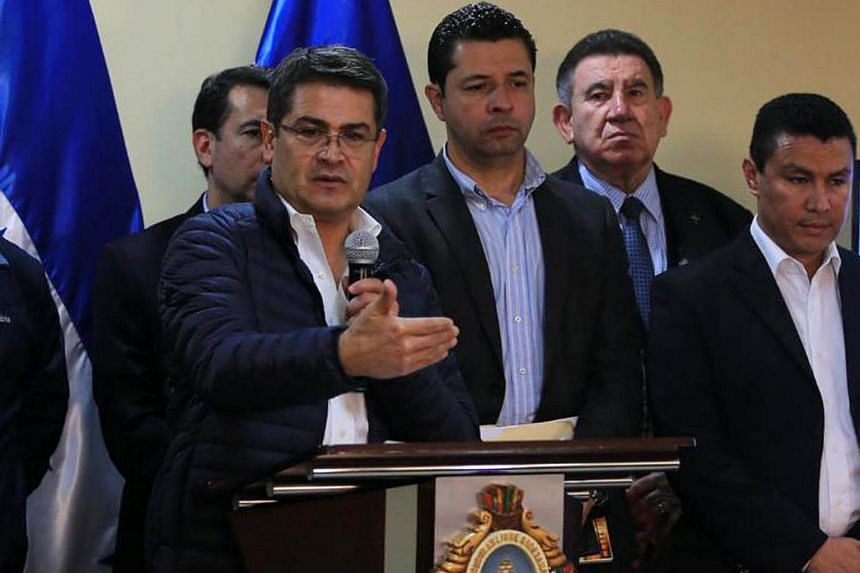Incumbent President Juan Orlando Hernandez (left) beat Salvador Nasralla, a TV star, by 1.53 percentage points, according to the official count.