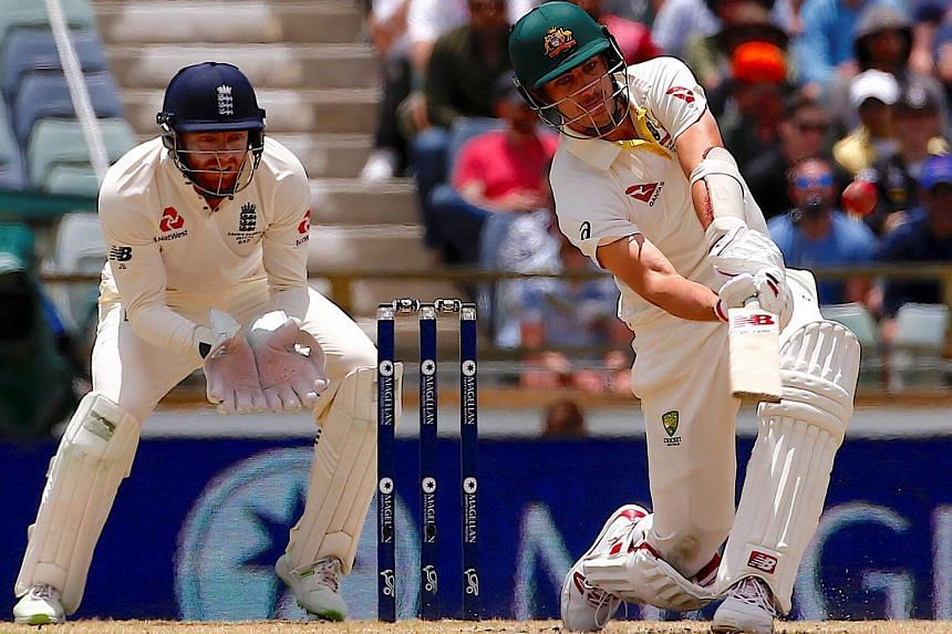 England's wicketkeeper Jonny Bairstow watches Australia's Pat Cummins hit a six during the fourth day of the third Ashes cricket test match.