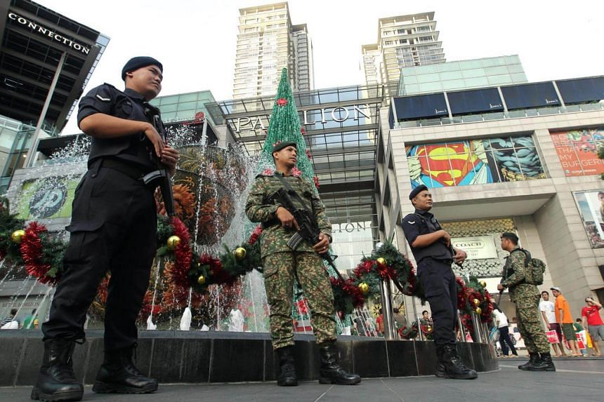 File photo of Malaysian armed forces and police personnel patrolling near the entrance of Pavilion KL mall before Christmas Day celebrations in 2016.