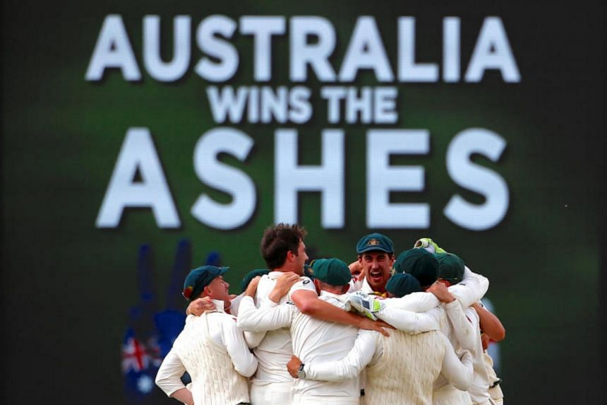 Australian players celebrate after winning the third Ashes cricket test match against England on Dec 18, 2017.