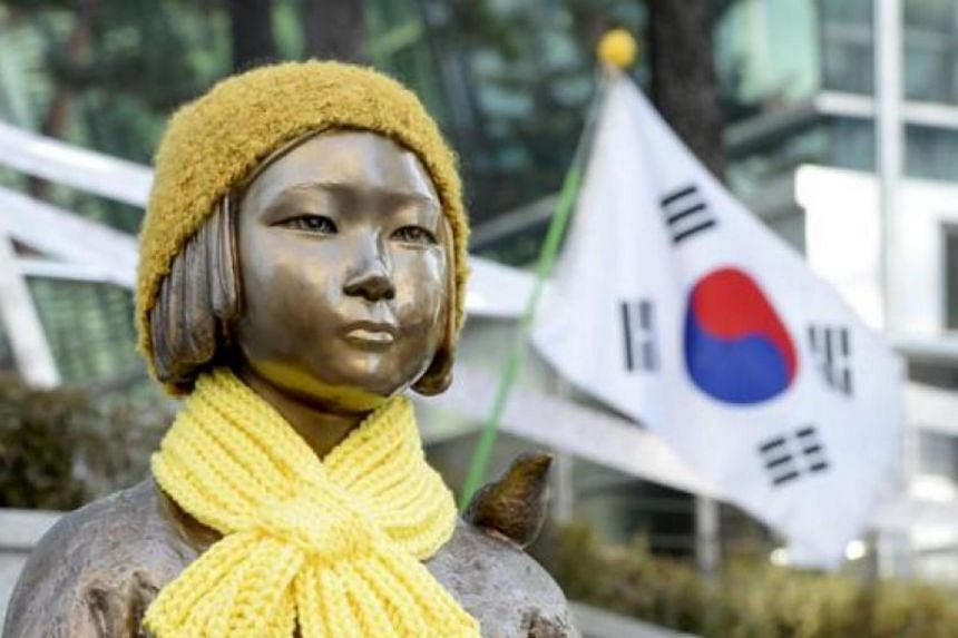 A statue of a girl that represents the sexual victims by the Japanese military in front of Japanese embassy in Seoul on Dec 28, 2015.
