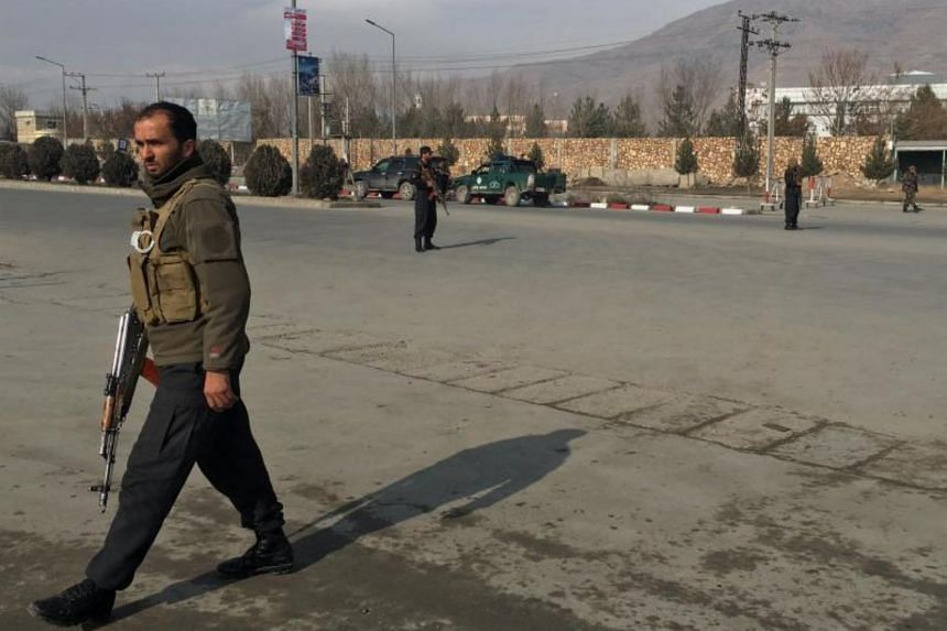 Afghan security officials secure the area around the scene of an attack on the National Directorate of Security training centre in Kabul on Dec 18, 2017.