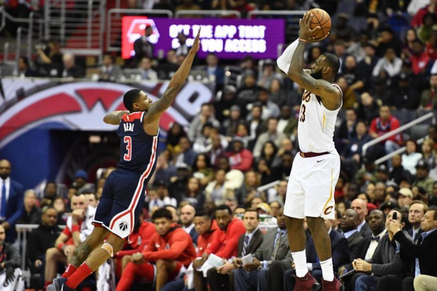 LeBron James shoots a three point basket during the second half of the NBA game against Washington Wizards at Capital One Arena in Washington, DC on Dec 17, 2017.
