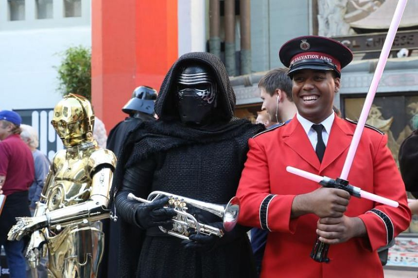 A Salvation Army representative poses with Kylo Ren from Star Wars: The Last Jedi before the film's premiere at the TCL Chinese Theatre in Hollywood, California, USA, on Dec 14, 2017.